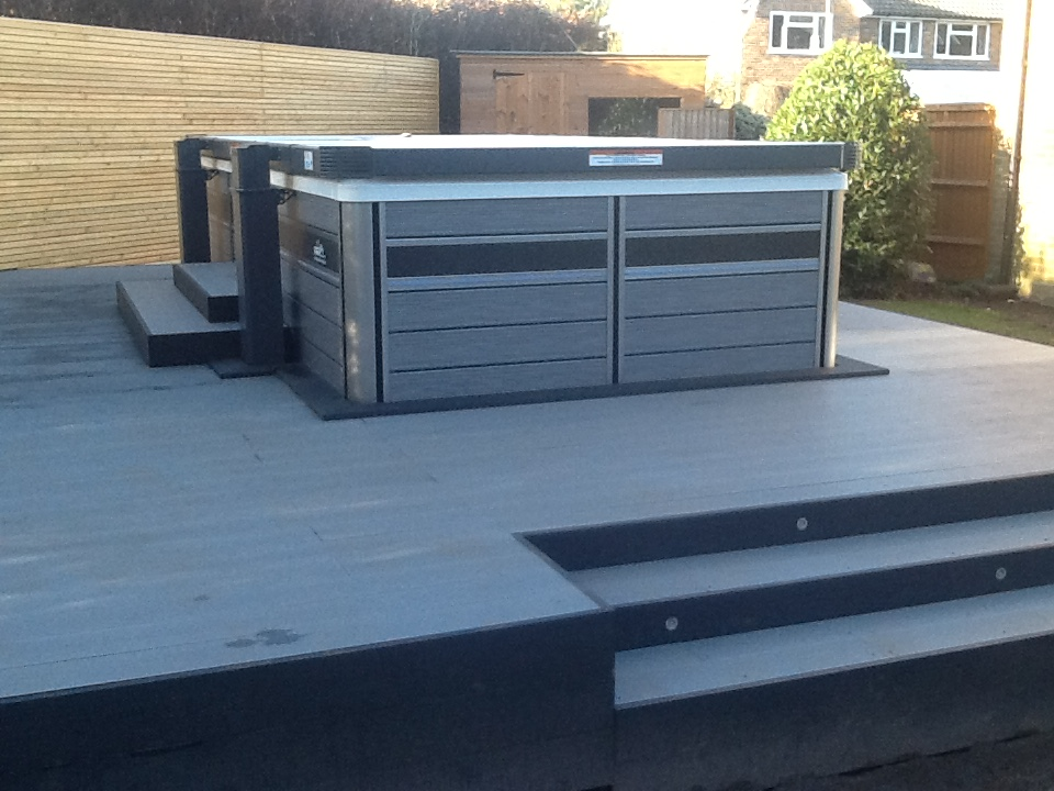 Decking - A large composite decked area to house a hot tub,  this looks very striking in grey with black edging