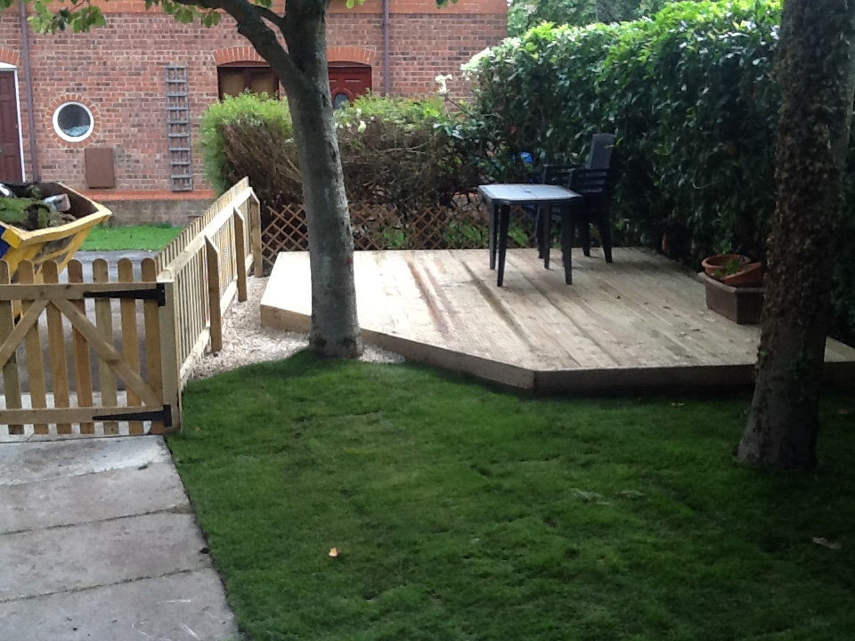 Decking - Area of soft wood decking, new fence and turf. This utilised a waste area which was overgrown and unsightly