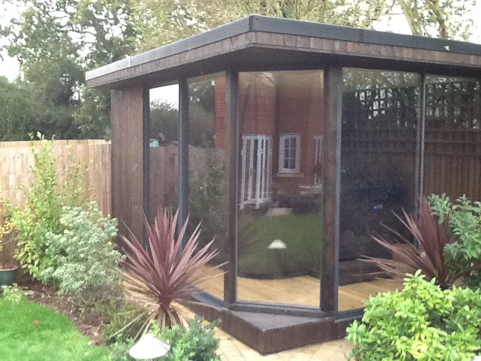 Garden Studio - built to house a hot tub, the design included full glass front walls to maximise the views of the beautiful garden.