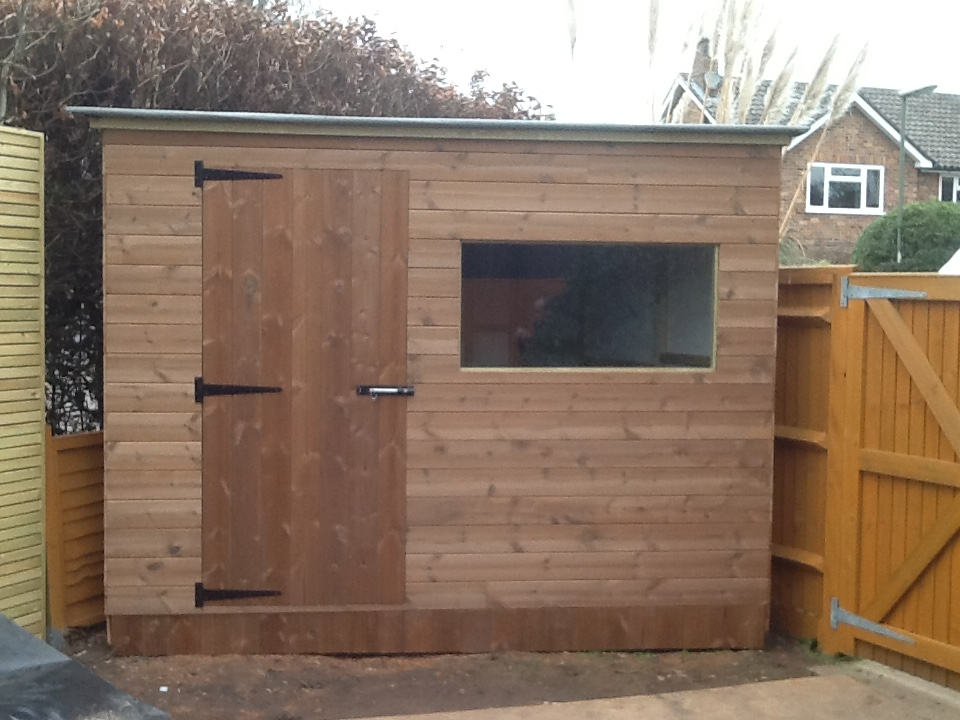 Shed - Triangular shed using thermowood utilising a wasted corner of the garden